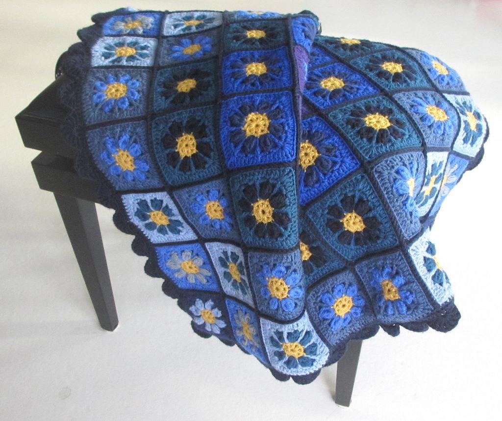 blue draped on piano stool